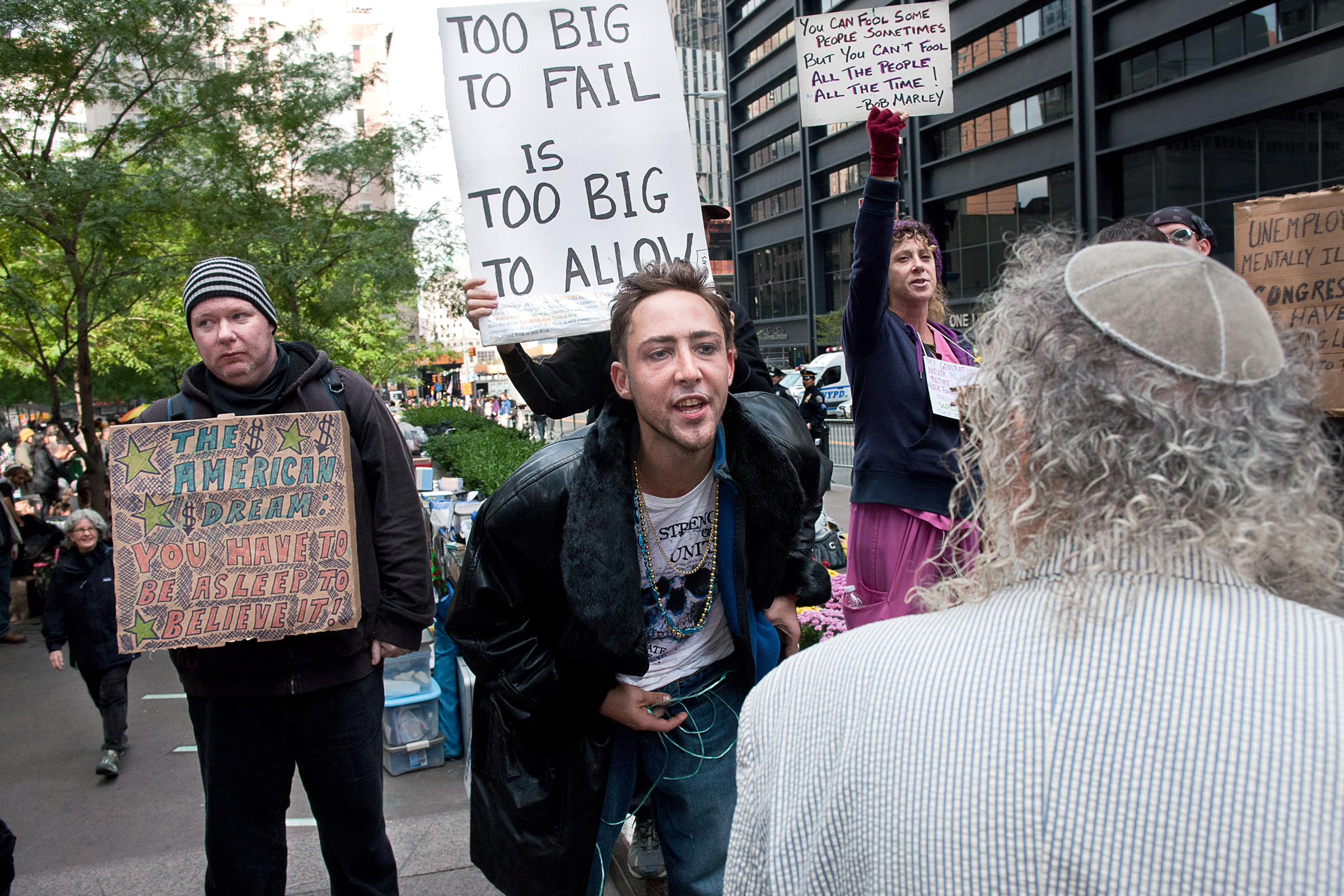 Protester Danny Cline contests a Jewish passerby who questioned the politics of Occupy Wall Street.
