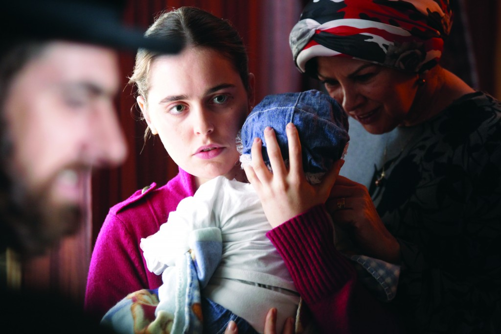 Luminous newcomer: Shira, played by Hadas Yaron, with her sister's child.