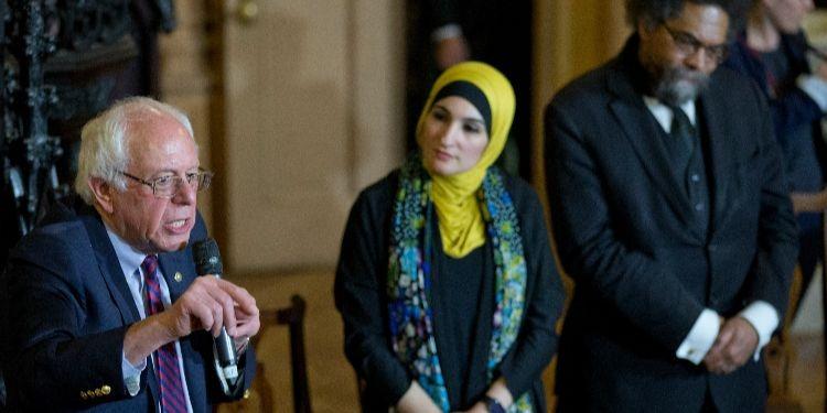 Linda Sarsour looking at Bernie Sanders
