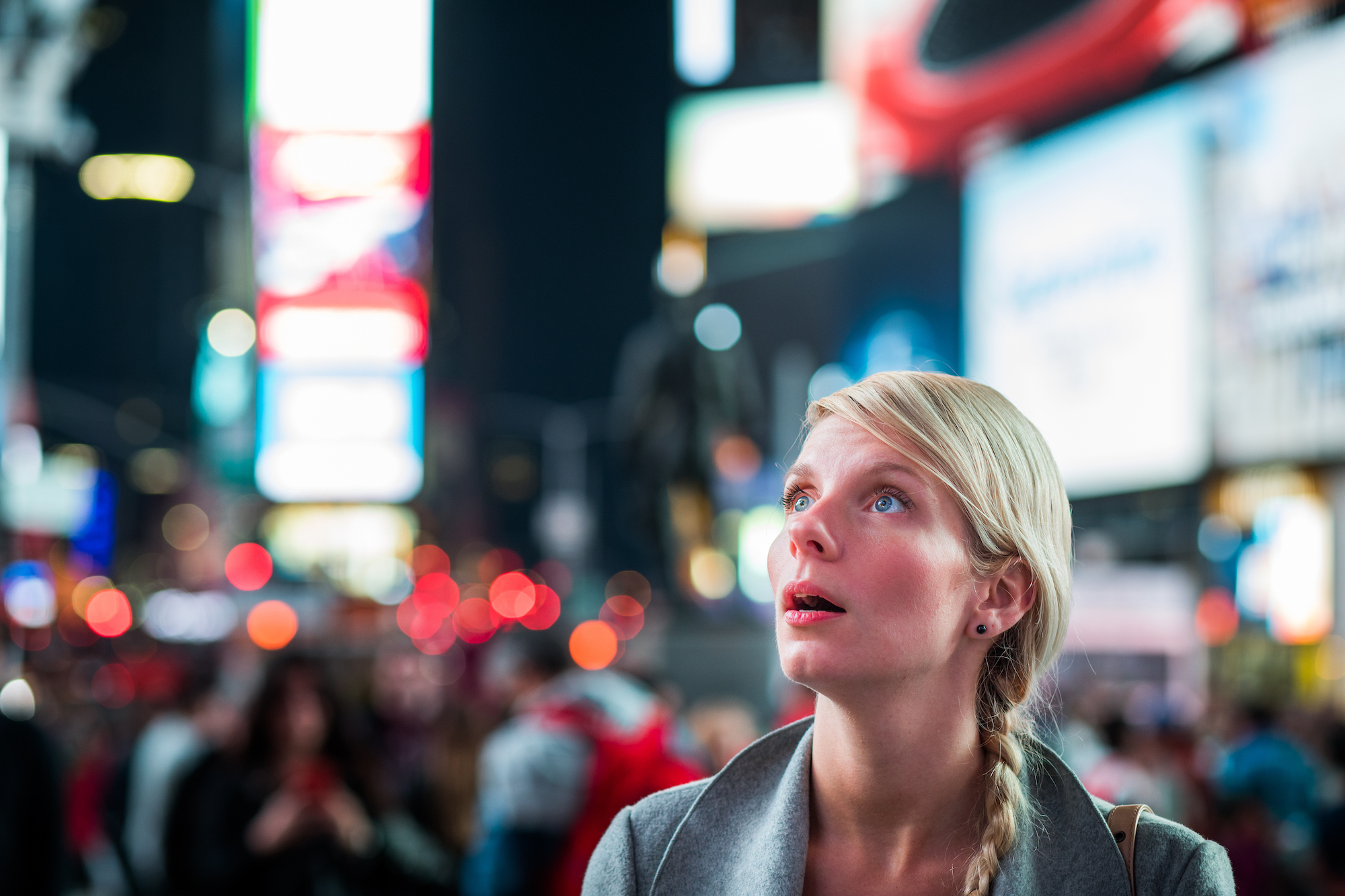 modernity can be confusing, woman looks lost in Times Square